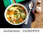 chicken soup with vegetables | Shutterstock . vector #1124029925