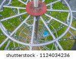 blue disc under disc golf basket | Shutterstock . vector #1124034236