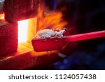 hot item is inserted into the... | Shutterstock . vector #1124057438