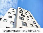 modern apartment buildings on a ... | Shutterstock . vector #1124099378
