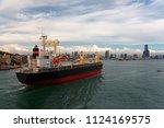 a cargo ship makes its way into ...   Shutterstock . vector #1124169575