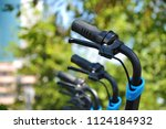 close up of the shared bike's... | Shutterstock . vector #1124184932