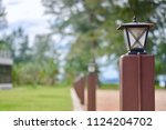 old street lamp in front yard. | Shutterstock . vector #1124204702