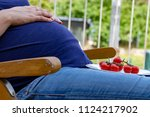 Pregnant Woman Sitting In The...