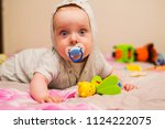 baby with a nipple lying on his ... | Shutterstock . vector #1124222075