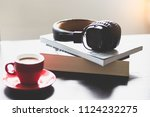vintage headphone on books with ... | Shutterstock . vector #1124232275