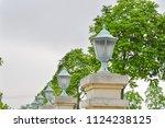 antique road lamp in the street. | Shutterstock . vector #1124238125
