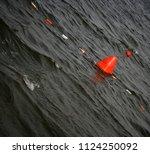 floating red navigational buoy... | Shutterstock . vector #1124250092