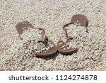 flip flops on the beach   Shutterstock . vector #1124274878