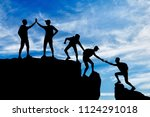 silhouette of five climbers who ... | Shutterstock . vector #1124291018