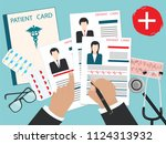 male hands with a pen   medical ... | Shutterstock . vector #1124313932