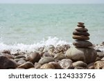 pyramid of stones against the... | Shutterstock . vector #1124333756