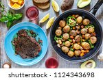 dinner table  frying pan with...   Shutterstock . vector #1124343698