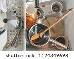 full kitchen sink of dirty... | Shutterstock . vector #1124349698