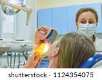 the girl checks the dentist... | Shutterstock . vector #1124354075
