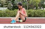 sport woman getting hurt on...   Shutterstock . vector #1124362322
