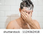 the soap fell into my eyes. the ...   Shutterstock . vector #1124362418