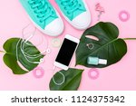 bright summer accessories on a... | Shutterstock . vector #1124375342