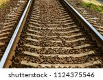 old railroad tracks in... | Shutterstock . vector #1124375546
