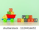 colorful toy truck with... | Shutterstock . vector #1124416652