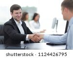handshake business partners at... | Shutterstock . vector #1124426795
