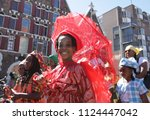 Small photo of AMSTERDAM,NETHERLANDS - JULY 1, 2018: take part during Bigi Spikri celebration of the Reminding Abolition of Slavery Day on July 1, 2018in Amsterdam,Netherlands.