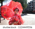 Small photo of AMSTERDAM,NETHERLANDS - JULY 1,2018: A young girl take part during Bigi Spikri celebration of the Reminding Abolition of Slavery Day on July 1, 2018in Amsterdam,Netherlands.