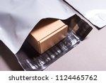 polyethylene envelope on grey... | Shutterstock . vector #1124465762