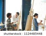 confident teacher consulting... | Shutterstock . vector #1124485448