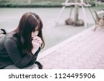 asian woman sitting alone and... | Shutterstock . vector #1124495906