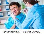 patient afraid of dentist... | Shutterstock . vector #1124520902