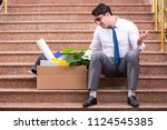 young businessman on the street ... | Shutterstock . vector #1124545385