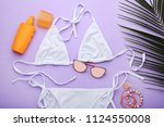 white swimsuit with green palm... | Shutterstock . vector #1124550008
