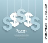dollar signs hanging on the... | Shutterstock .eps vector #1124560835