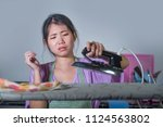 young pretty frustrated and... | Shutterstock . vector #1124563802