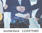 business man and engineer... | Shutterstock . vector #1124575385