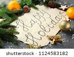 inscription happy holiday with... | Shutterstock . vector #1124583182