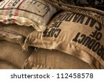Stack Of Burlap Sacks With...