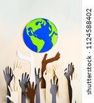 humans hands raised up towards... | Shutterstock . vector #1124588402