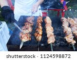 man's hands grilling meat and... | Shutterstock . vector #1124598872