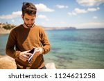 young man looking on the map | Shutterstock . vector #1124621258