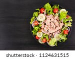 salad with tuna and vegetables. ... | Shutterstock . vector #1124631515