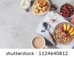 healthy breakfast with granola... | Shutterstock . vector #1124640812