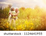 loving mature couple  in summer ... | Shutterstock . vector #1124641955
