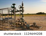 oil and gas facilities | Shutterstock . vector #1124644208