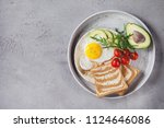 breakfast with fried egg with... | Shutterstock . vector #1124646086