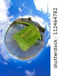 Little planet panorama of a lake - stock photo
