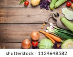 different raw vegetables over... | Shutterstock . vector #1124648582