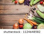 different raw vegetables over... | Shutterstock . vector #1124648582