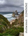 praia da ursa beach below the... | Shutterstock . vector #1124656562